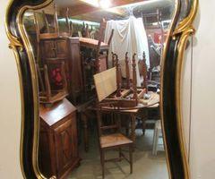 Miroir bois et stuc doré et noir , vendu