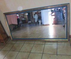 Tres grand miroir doré à la feuille d'or ,vendu
