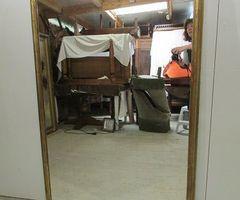 Très grand miroir à poser doré à la feuille ,vendu
