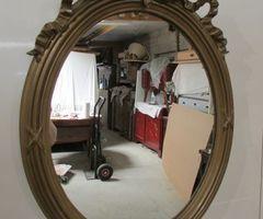 Miroir ovale de style Louis XVI ,vendu