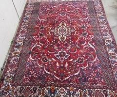 Grand tapis iranien en laine ,vendu