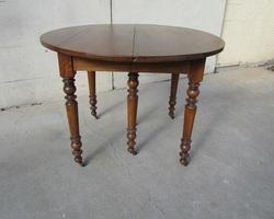 Table ronde 6 pieds ouvrante en noyer massif  , 5 allonges